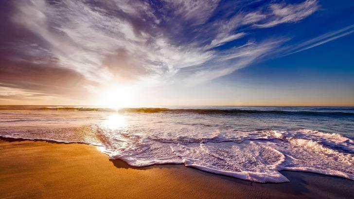 beach scene with sun