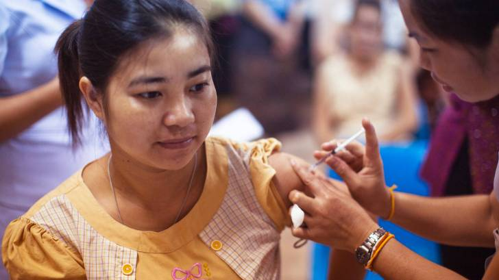 girl getting a vaccine