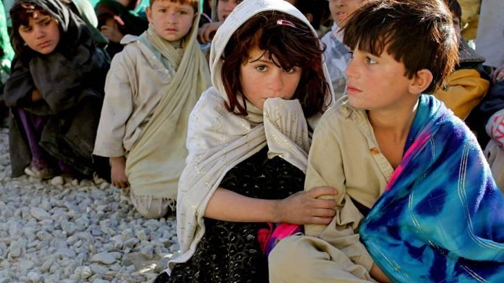 Afghan children sitting in a line
