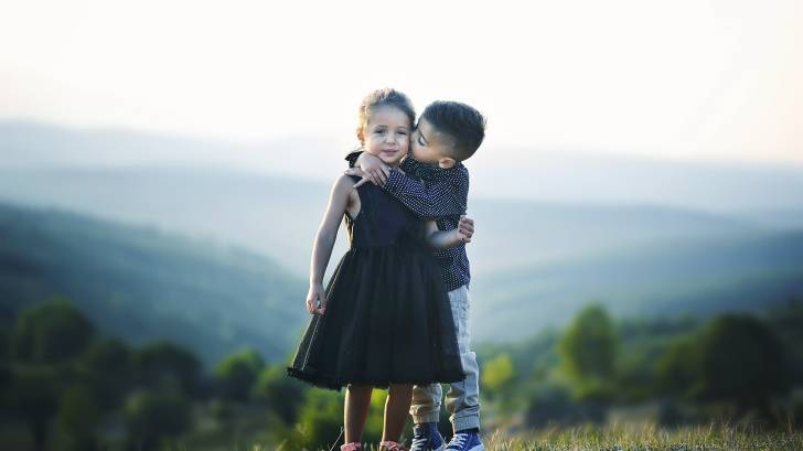 children hugging each other.