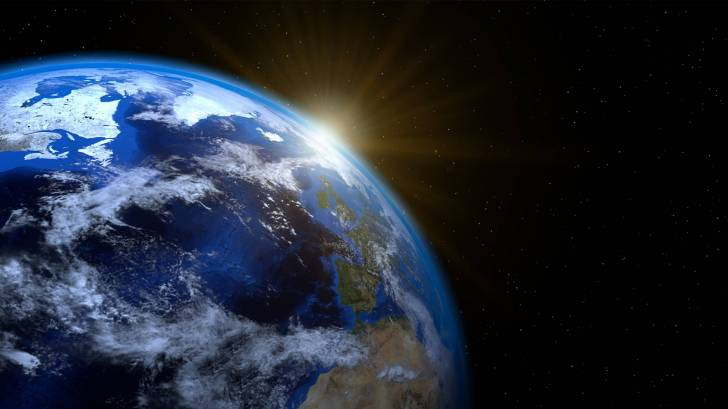 plnet earth with the sun rising