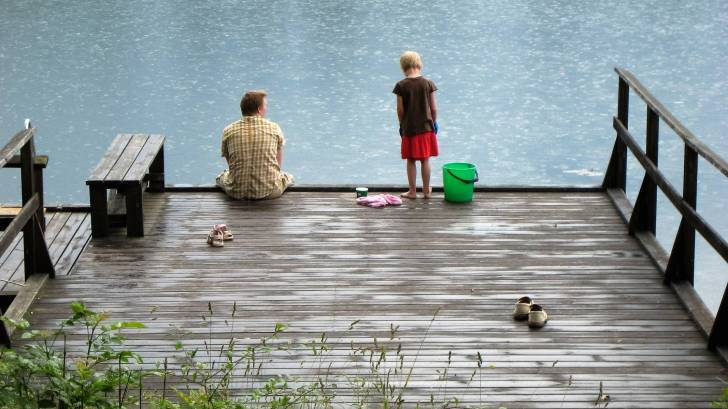 dad and son on dock fishing, happy to be alive