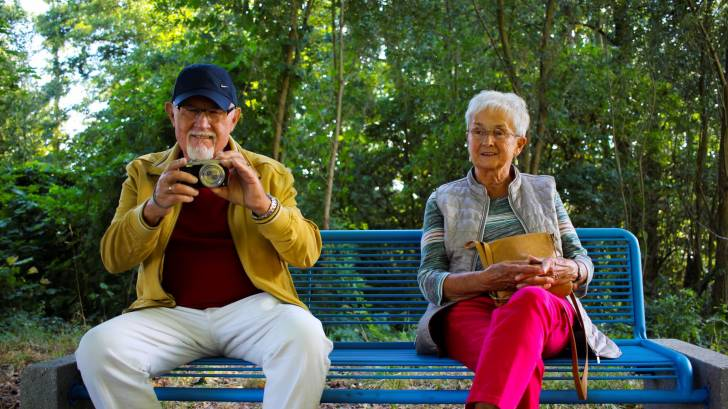 grandparents sitting on a bench