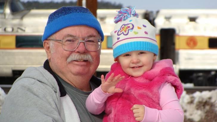 smiling grandpa with grand daughter