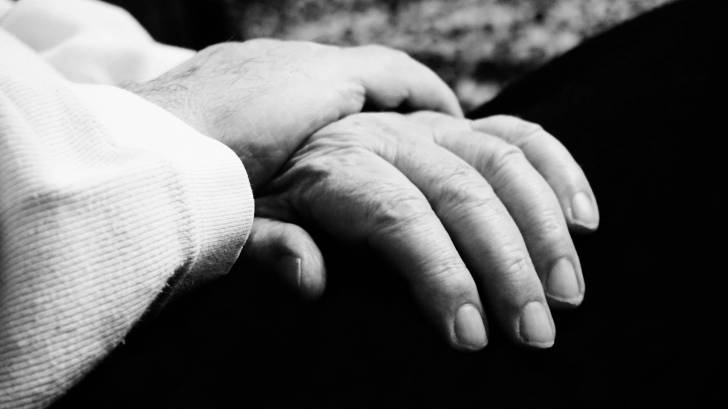 older person hand in lap