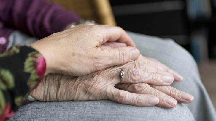 older hands holding