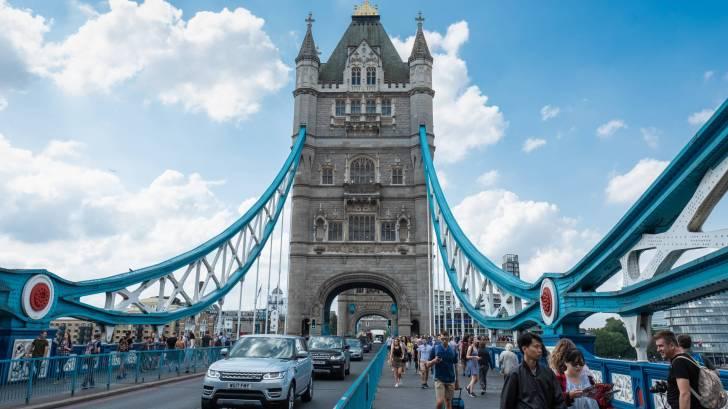 london bridge with people and children walknig on it