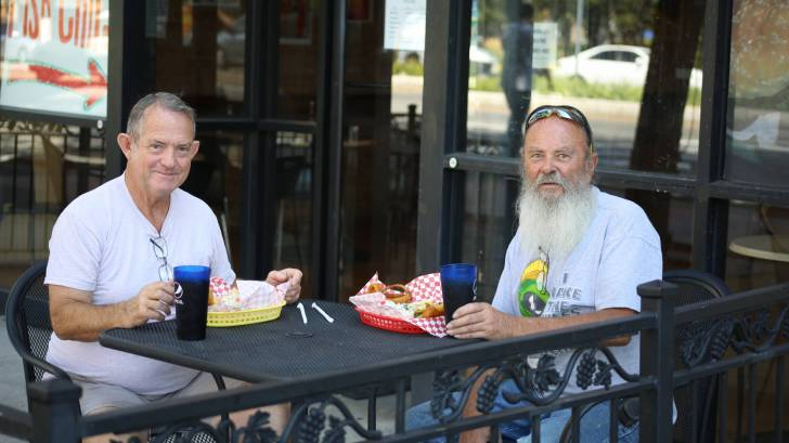 men enjoying lunch