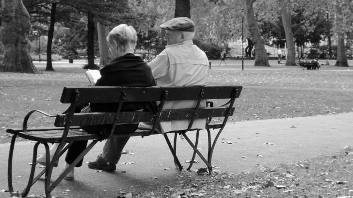 older folks sitting on a bench
