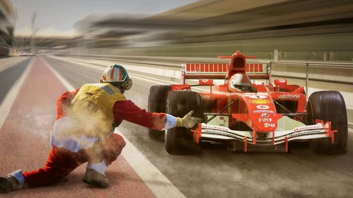 formula one racing car in the pit restarting the race
