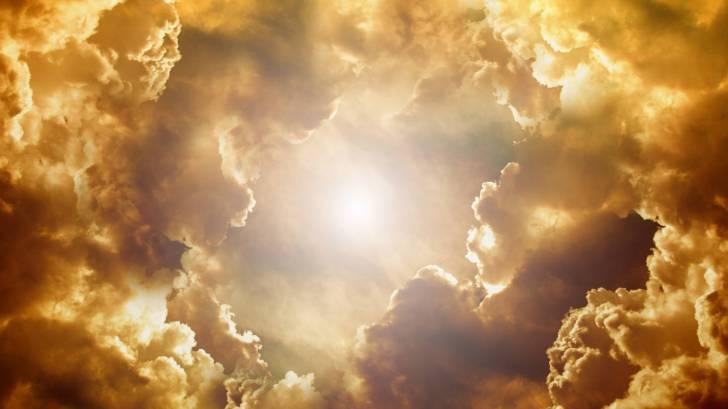 sun peaking thru the clouds