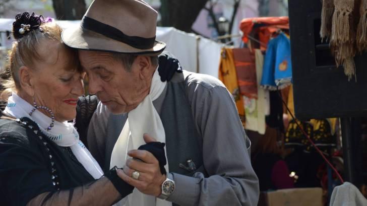 argentinan's dancing the tango at a street fair