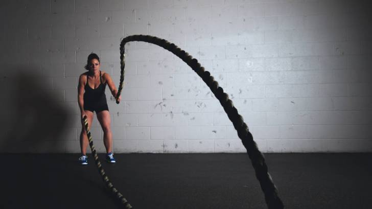 woman training with ropes to get stronger