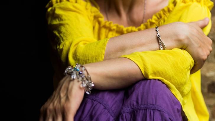 woman in yellow shirt
