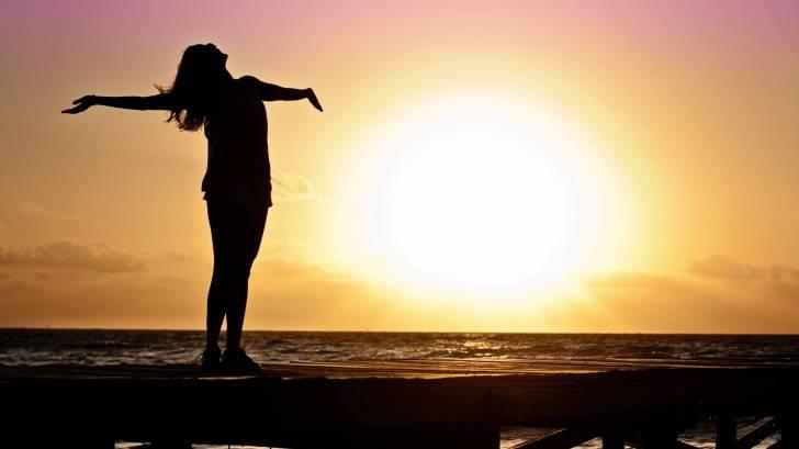 woman celebrating the sunrise