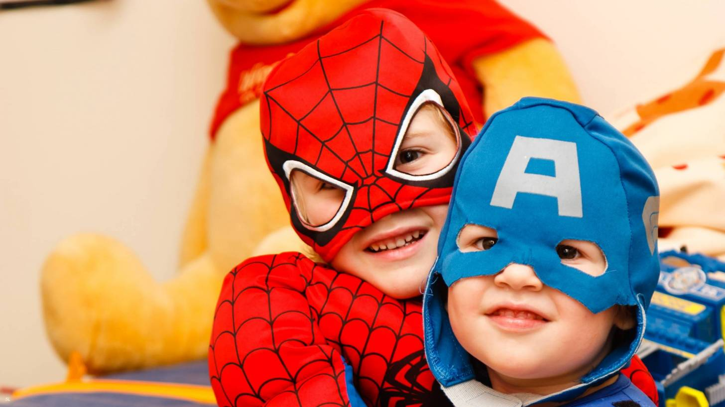 toddlers dressed as super heroes