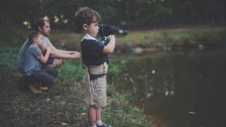 fishing in a pond with dad