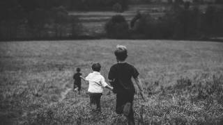 boys running in a field