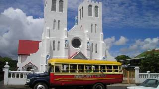 samoan bus parked in front of a church