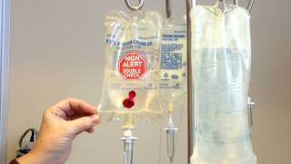 chemo therapy bags hanging from the rack