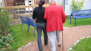 women walking arm in arm