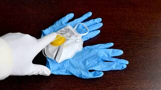 protective mak and gloves for health care workers