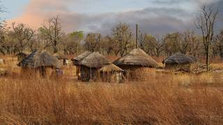 west africa huts in the hot desert