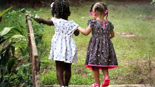 young girls holding hands