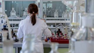 researchers in a lab working to produce vaccines