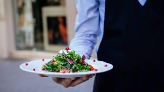 waiter serving a salad