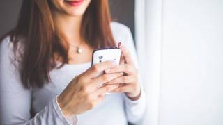 woman looking at her smart phone app