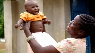 mother with smiling healthy baby