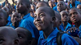 young african boys in school uniforms happy and smiling