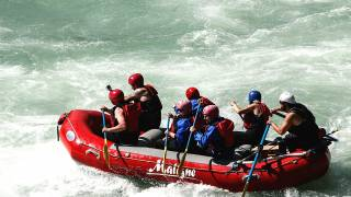 men on white water raft
