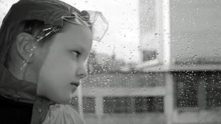 cold kid in rain