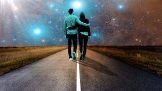 couple walking along a road in the starry night