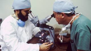 scientists testing with microscopes