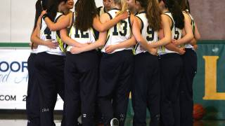 girls basketball team hugging
