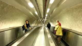escalator, senior couple and yong woman