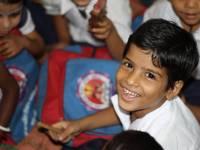 young healthy happy boy in school