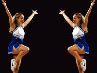 cheerleaders showing sign for victory