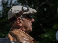 older man driving a car