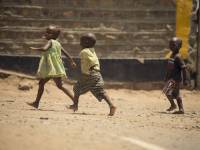 young african children playing in a yard